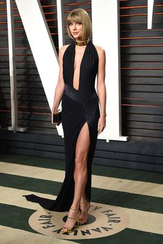 Taylor Swift modelled a whole new look in this cutaway, black, slinky dress at Vanity Fair's Oscars Party