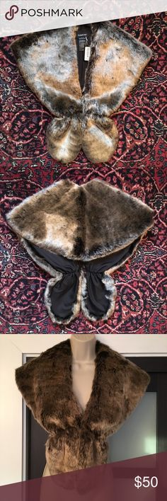 Bebe Faux Fake Fur Wrap Shawl Brown Small Here is a NWT bebe faux or fake fur wrap/ shawl in a brownish- tan color that kind of changes appearance depending upon the lighting, or which way you stroke the fur! It has a hook closure so you can close it in the front, as shown on the mannequin. bebe Accessories Scarves & Wraps