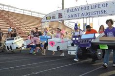 Team members take to the track during the boxcar race at the 2011 Relay For Life of St. Augustine.
