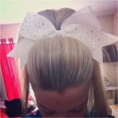 Kelcies hair = perfect! : perfect poof, bling bow, perfect pony. Ugh cheer season lets go!