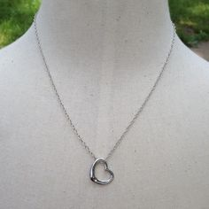 Simple Heart Necklace Cute silver toned heart necklace. New in package. Chain is about 18 inches. Lobster clasp closure. Jewelry Necklaces