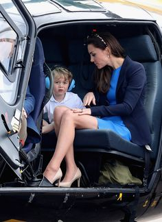Catherine, Duchess of Cambridge, Prince William, Duke of Cambridge and Prince George sit in a Squirrel helicopter during a visit to the Royal International Air Tattoo at RAF Fairford on July 8, 2016 in Fairford, England.