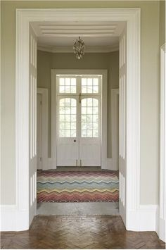 Farrow & Ball Old White - greeny, even in North facing rooms.  (paint colours look greener in rooms with lots of light, and more blue when north facing, or less light.