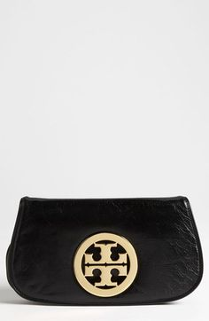 Free shipping and returns on Tory Burch Logo Flap Clutch at Nordstrom.com. Signature cutout logo hardware brands the front flap of a slim clutch crafted from rich, lightly textured leather and furnished with a removable chain strap for added versatility.
