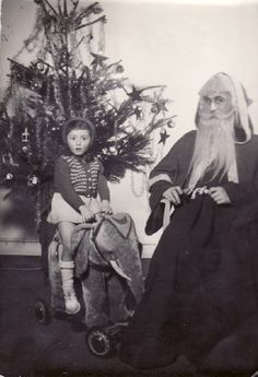 Vintage Christmas Photo: Father Christmas and young girl on a miniature elephant. South of France.