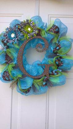 deco mesh wreath - will do something similar for Christmas - i don't do red and green - this year will be leopard ribbon w/blue and metallics