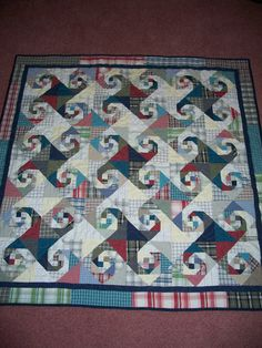 """This is a """"Snail's Trail"""" pattern and I made it from my son's discarded shirts. Shirt Quilts, Snails, Print Patterns, Quilting, Blanket, Rugs, Prints, Home Decor, Scrappy Quilts"""
