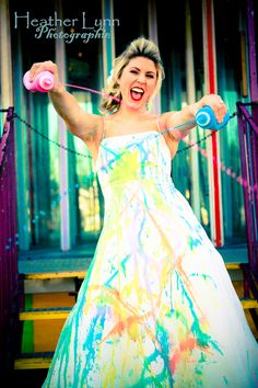 not normally a trash the dress fan...but paint and a carnival? ooh la la.