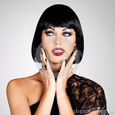 Fashion photo of a beautiful brunette woman with shot hairstyle. by Valua Vitaly, via Dreamstime