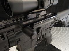 The GFG Side Charger is a replacement charging handle for the AR-15 that wraps around the receiver allowing it to be manipulated from the side of the receiver rather than the rear of the receiver. Its main advantage over an extended latch charging handle, such as the BCM gunfighter, is that is allows manipulation of the bolt catch with the same hand as the charging handle.