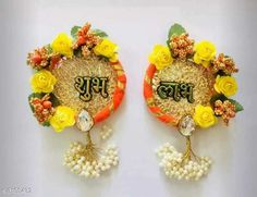Religious Idols & Paintings Elite Shubh-Labh Hangings For Diwali Festival Material : Flowers  Size: 6 in Description: It Has 1 Sets Of Doors Shubh-Labh Hangings For Diwali Festival Work: Pom Pom & Beads Country of Origin: India Sizes Available: Free Size   Catalog Rating: ★3.9 (1241)  Catalog Name: Elite Trendy Shubh-Labh Hangings For Diwali Festival Vol 1 CatalogID_425486 C128-SC1316 Code: 891-3103432-