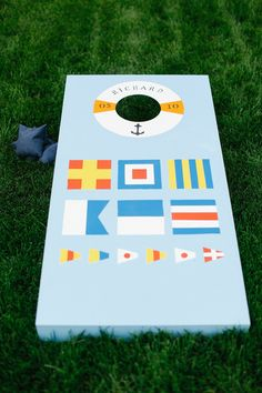 Nautical-Themed Cornhole Board    Photography: Luke %26 Katherine Griffin for Max %26 Friends   Read More:  http://www.insideweddings.com/weddings/tent-wedding-with-chic-nautical-theme-on-la-playa-bay-in-san-diego/737/