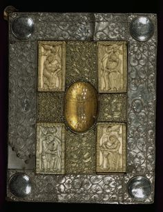 sexycodicology:  Mondsee Gospel Lectionary, Rock crystal with crucifixion, and ivory evangelist portraits, Walters Manuscript W.8, Upper board outside by Walters Art Museum Illuminated Manuscripts http://flic.kr/p/oCr1dD