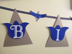 Egyptian Birthday Party Banner. Pyramids with Blue Lotus flowers and scarab beetle detail on ribbon. #papercrafts #cricut #egypt