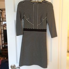 NWT Karen Millen Striped Dress This brand new with tags designer dress by Karen Millen does it all with structured shape but stretch, black & white stripes arranged around bodice to highlight best features, zipper-back for a little fun, and side pockets for a little more function!  The best about this is due to the light material and 3/4 length sleeves, it can be worn in summer, and in fall/winter will look equally great with opaque tights and boots/booties!  65% viscose, 30% polyamide, 5%…
