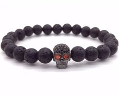 Lava bracelets are the newest way to enjoy the benefits of aromatherapy. To use, add drops of essential oil to the lava stones, let dry, and enjoy the essential oil benefits all day! Size can be customized for fit. If one of the sizes here does not wor Bracelet Viking, Lava Bracelet, Skull Bracelet, Stone Bracelet, Bracelet Set, Mode Punk Rock, Style Punk Rock, Bracelets For Men, Fashion Bracelets