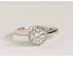 My other favorite!  Monique Lhuillier Draping Halo Diamond Engagement Ring in Platinum | Blue Nile