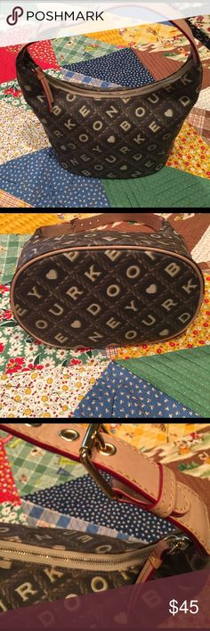 """Dooney and Bourke bag!  Like new! Nice neutral! Like new carried once! Inside is perfect red color on edges pink and white tiny check inside! 2 pockets inside ! Coated canvas nice light weight bad! 9"""" across bottom, 7"""" bottom to top, handle is 13"""" ! Questions welcome . Dooney & Bourke Bags Shoulder Bags"""
