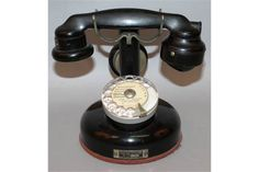 Lot 544 - A FRENCH BLACK BAKELITE TELEPHONE.