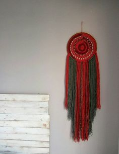 Check out this item in my Etsy shop https://www.etsy.com/uk/listing/261760986/dream-catcher-bohemian-decor-in-reds-and