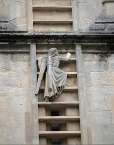 Details, details...Angel climbing the ladder to heaven, outside of the abbey in Bath, England.