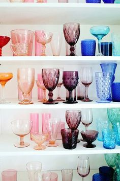 Vintage glassware arranged by color