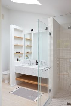 Really loving the layout of this bathroom. Fun use of space for a guest bath where a lot of storage isn't needed.Lisa Jones' Shelter Island House Bathroom with Shower, Photo by Jonathan Hokklo Rustic Bathrooms, Modern Bathroom, Small Bathroom, Master Bathroom, Bathroom Closet, Bathroom Ideas, Bathroom Inspo, Bathroom Layout, White Bathroom