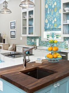A wooden counter would do a lot of making the place look fancy and coastal along with the blue walls and tiles. And just add some fruits to complete the vibe.