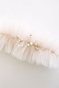 A blush ruffled tullegarter with rhinestone embellishment.Please leave a  note with your measurements to have a perfect fit.  100% Handmade  If you would like to customize this piece in a different color, or size  please email info@handmadebysarakim.com. Please check our store policy for  processing time and current order status. If you need your order shipped  before our standard processing time, please contact us for more details.