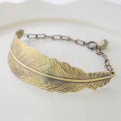 Feather Bracelet by Olive Yew, $30. This unique brass feather bracelet includes a small faceted pyrite chunk.