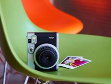 Instax - basically the new polaroid.  http://www.fujifilm.com/products/instant_photo/cameras/instax_mini_90/
