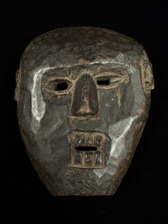 """Mask from the Middle Hills, Nepal. 10"""" (25 cm) high by 8"""" (20 cm) wide Early 19th century or earlier"""