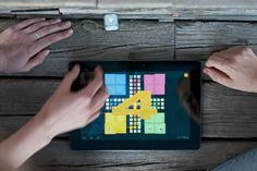 Your favorite board games played on a tablet together with an electronic dice, DICE+.