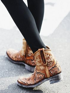 Queenwood Western Boot | Authentic leather ankle boots, western-inspired with hand-stitched detailing and an allover floral design. Embellished pull-tabs at topline.
