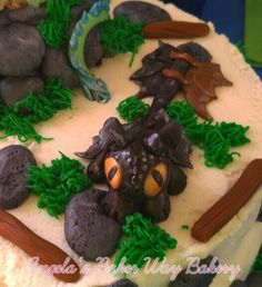 Toothless dragon baby shower cake.