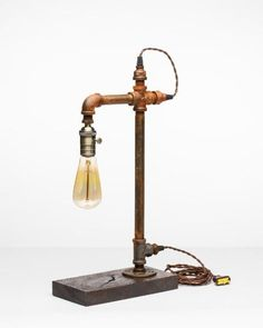 American Made Searcy Lamp Set a soft glow with the industrial style Searcy Lamp. Fabric cable and brass light socket. #lamps #lighting