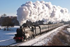 'Black 5' No 45337 heading through Burrs on a Santa Special, on the East Lancashire Railway, in the UK