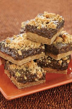 Delicious Lion House oatmeal fudge bars - 1 cup butter or margarine softened, 2 cups packed brown sugar 2 eggs, 2 teaspoons vanilla, 2½ cups all-purpose flour, 1 teaspoon baking soda, ½ teaspoon salt, 1½ cups quick-cooking rolled oats, 1 (14-ounce) can sweetened condensed milk, 1 (12-ounce) package semisweet chocolate chips, ¼ cup margarine, 2 teaspoons vanilla, 1 cup chopped walnuts, optional