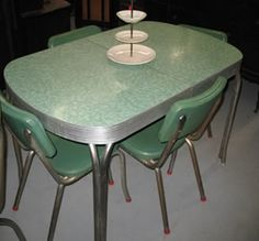 Love this chrome table from the 50's.  Have one just like it in my garage that belonged to my husband's grandparents.  Hubby and I used it early in our marriage.  I wanted it refinished for my birthday, but hubby couldn't find anyone to re-chrome it or reupholster the chairs.  Of course....he always said he hated that dinette set.  So he just bought me a brand new table and chairs.