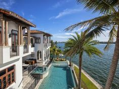 Pool and Home Exterior: Waterfront Mansion Featured in Kourtney and Kim Take Miami