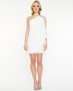 One Shoulder Chiffon Dress - A charming appliqué adorns the one shoulder of this dramatic asymmetrical dress.