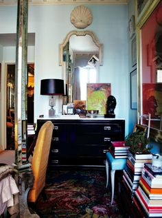 Miles Redd: his dresser and stacks of books in his bedroom