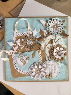 Marianne creatables, apron die, with some mixed flower dies including Spellbinders. Love the colours I've used