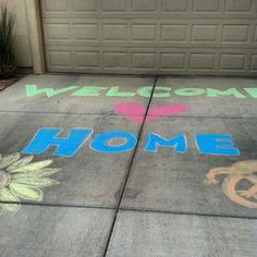 A ton of welcome home sign ideas, but I really LOVE the chalk in the driveway!