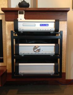 Musical Fidelity A5 pre/power amp with A5.5 CD player in AV cabinet work I constructed myself.  Audio gear on 10mm glass platters supported on adjustable spikes in purpose built steel frame bolted to brick wall surrounded by cabinet work which has CD rack and TV incorporated.