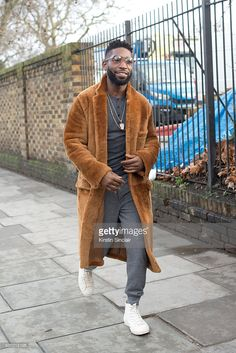 English rapper Tinie Tempeh wears Burberry coat and trousers on day 4 of London Collections: Men on Januay 11, 2016 in London, England. (Photo by Kirstin Sinclair/Getty Images)Tinie Tempeh