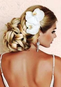 Brides stunning chignon braid wedding hair ideas Toni Kami Wedding Hairstyles orchid accents drop earrings