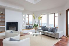 Recessed lights and large windows help illuminate the space.