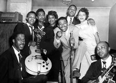 Little Walter and his Jukes at the Zanzibar Club in Chicago, IL, c. 1955/56 l to r: Fred Below, Luther Tucker, Little Johnny Jones, unknown female (Bill Hill's wife Mary ?), Little Walter, unknown male (DJ Big Bill Hill ?), unknown female (Johnny Jones' wife Letha ?), Robert Jr Lockwood; source: ebay auction; photographer unknown; photoshop processed by Stefan Wirz; BTW: PA system top left is a Bell Sound 3725 (amplifier) and (half of) a Danelectro Commando (speaker)