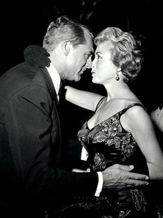 Cary Grant and Janet Leigh greet each other at an unspecified event, c. late 1950s.